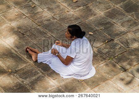 Kandy, Sri Lanka - July 19, 2016: White Clothed Buddhist Pilgrim During Poya Full Moon Holiday In Ka