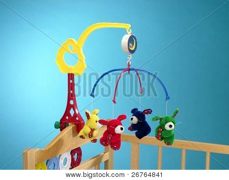 Hanging toy attached to a baby cot