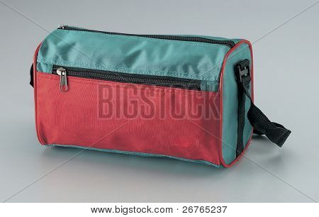 Studio shot of Duffel Bag. Colour - Green and red.