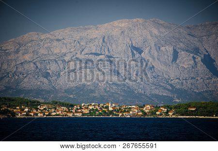 Sea View Of Small Town Sumartin Of Brac Island In Front Of Biokovo Mountain Range, Adriatic Sea, Cro