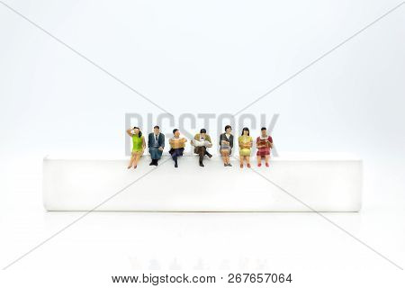 Miniature People, Sitting On White Block. White Block Can Write Anything For Various Occasions.