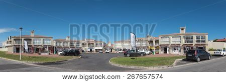 Yzerfontein, South Africa, August 20, 2018: A Shopping Centre, With Businesses And Vehicles, In Yzer