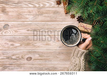 Woman Holding Cup Of Hot Coffee On Rustic Vintage Wooden Table. Hands In Warm Sweater With Mug, Wint