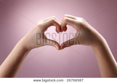 Human hand forming a love symbol.