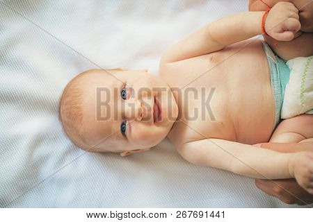 Newborn Baby Happy Smiling. Happy Newborn. Adorable Baby Girl Or Boy. Physical And Mental Developmen