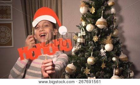 Girl Holding Banners With Words Hohoho Like Santa Says
