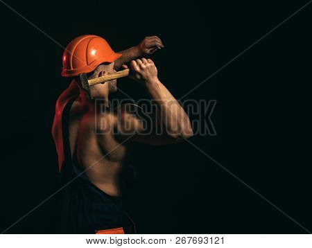 The Project Is Currently Under Construction. Man Work With Hammer. Construction Worker Hammer A Nail