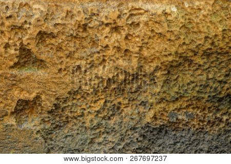 Brown Plastic Texture Of Dirty Foam Rubber In The Old Wall