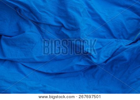 Blue Cloth Background Of Crumpled Matter On The Part Of Old Clothes
