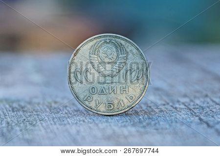 One Big Retro Soviet Ruble Stands On A Gray Table