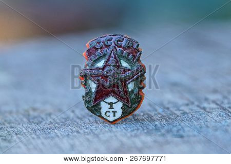 Old Soviet Sports Badge With Red Star On Gray Table