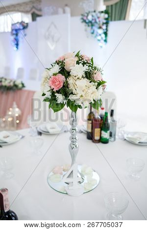 Decor With Flowers, Number, Botles, Dishes On The Table