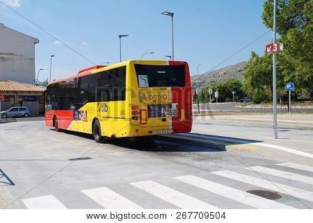 MAJORCA, SPAIN - SEPTEMBER 30, 2018: A TIB bus parked in the new bus station at Puerto Pollensa on the Spanish island of Majorca. The station was opened in June 2018 to relieve town centre congestion.