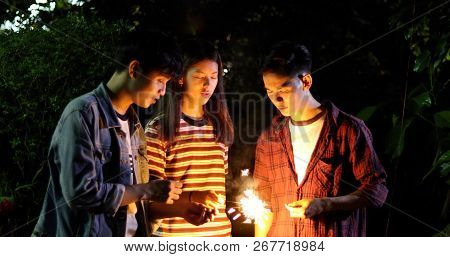 Asian Group Of Friends Having Outdoor Garden Barbecue Laughing With Alcoholic Beer Drinks And Showin