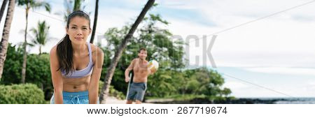 Beach volley ball friends team woman and man playing volley ball banner panorama. Summer outdoor activity. Young people having fun in the sun living healthy active sports lifestyle.