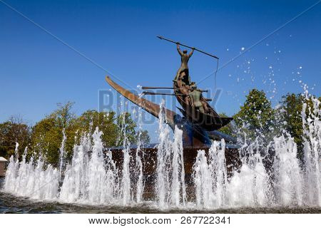 SANDEFJORD, NORWAY - JULY 21, 2018: The Whaler's Monument (The Whaling Monument), a rotating memorial statue and fountain by Norwegian sculptor Knut Steen representing Sandefjord as the capital