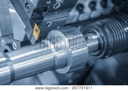 The Cutting Tool For Cnc Lathe Machine .the Cnc Lathe Machine Cutting  The Steel Shaft In The Light