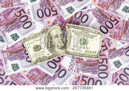 Torn Crumpled Hundred Dollars On The Background Of Money With A Face Value Of Five Hundred Euro