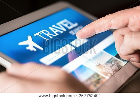 Travel Search Engine And Website For Holidays. Man Using Tablet To Look For Cheap Flights And Hotels