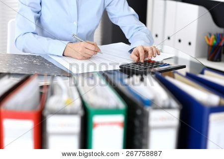 Bookkeeper Woman Or Financial Inspector  Making Report, Calculating Or Checking Balance, Close-up. B