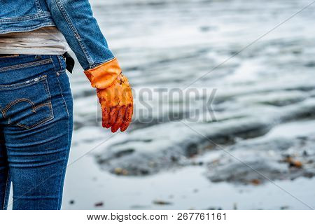 Volunteers Wear Jeans And Long Sleeved Shirts And Wear Orange Rubber Gloves To Collect Garbage On Th