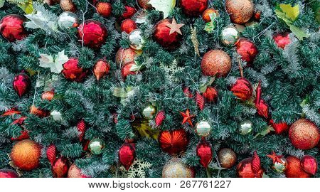 Close Up Christmas Tree Decoration With Red Ball, Gold Ball, Golden Snowflake, Red Star. Xmas Backgr