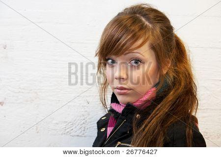 Teenage Girl By Wall