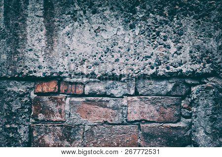 Old Shabby Brickwork Framed In Large Concrete Blocks. Retro Vintage Urban Background