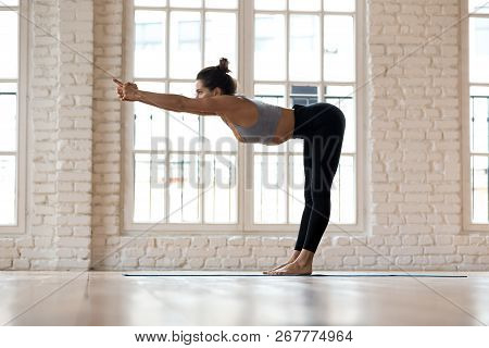 Sporty Woman Practicing Yoga, Doing Spine Muscles Stretch Exerci