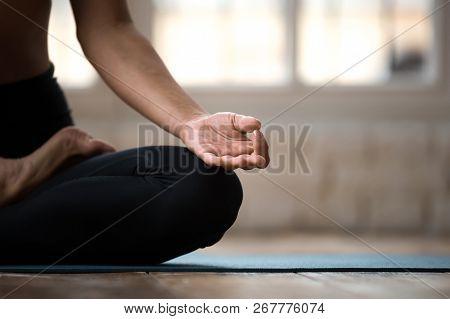 Sporty Yogi Woman Practicing Yoga, Doing Ardha Padmasana Exercis