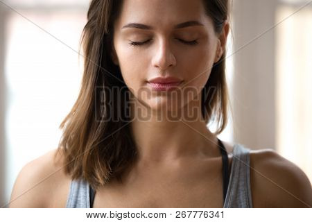 Portrait Of Attractive Yogi Woman Meditating, Close Up