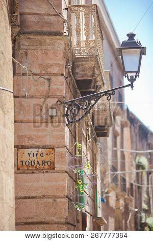 Taranto, Apulia, Italy - An Old Street Lamp Fixed At A House Facade