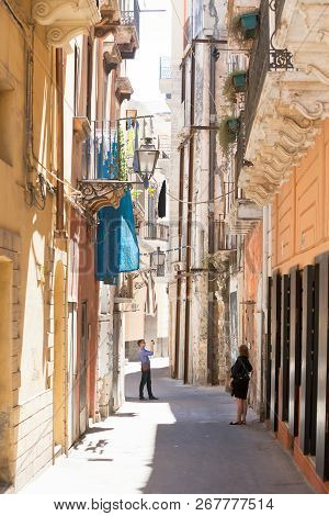 Taranto, Apulia, Italy - May 31, 2017 - Tourists Taking Photos While Visiting The Old Town