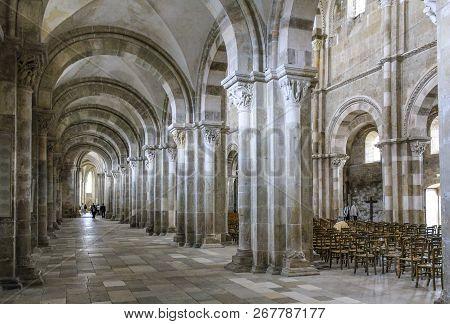 Vezelay, France - July 28, 2011: Tourists And Pilgrims Visit The Benedictine Abbey Church Of Vezelay