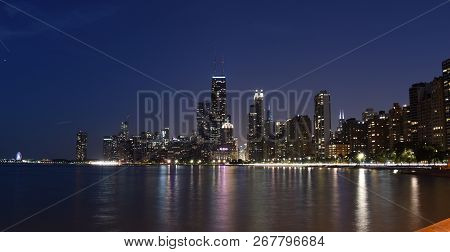 Chicago City Urban Skyscraper With John Hancock Center At Night At Downtown Lakefront Illuminated Wi