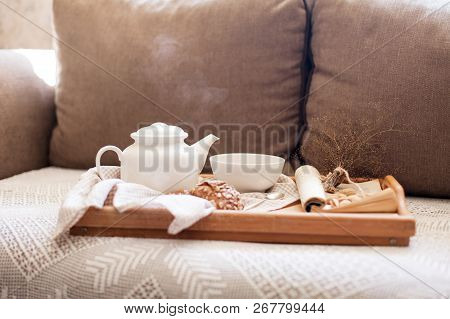 Wooden Serving Tray With White Teapot, Mug Of Steamy Hot Beverage In Cozy Home Interior. Food, Drink
