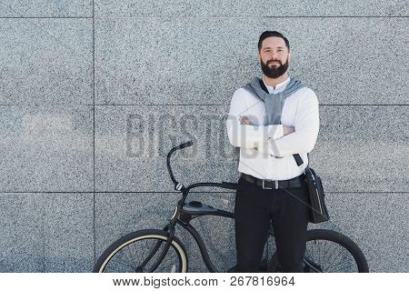 Urban Lifestyle, Ecology And Transportation Concept. Modern Ecologically Friendly Businessman Posing