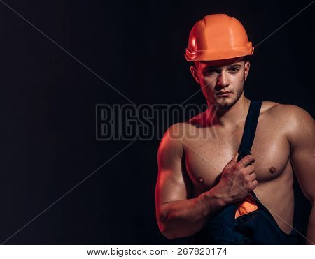 We Build Strong Foundations. Handsome Worker Or Workman. Muscular Man Wear Hard Hat And Uniform. Man