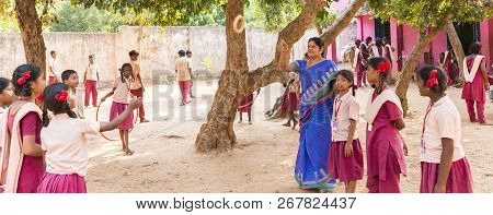 Puduchery, India - March Circa, 2018 : Unidentified Teacher Playing Game With Boys And Girls Smiling