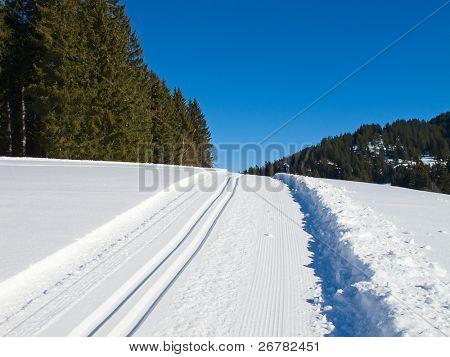 Freshly groomed empty cross-country ski track in swiss Alps