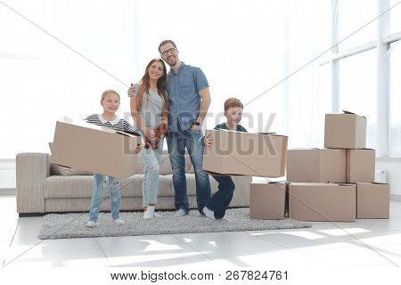 family moves the boxes to a new apartment.