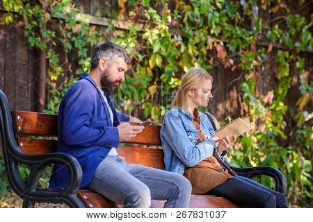 Reading Hobby Concept. Interesting Literature. Woman Read Book While Man Read Ebook Smartphone. Read