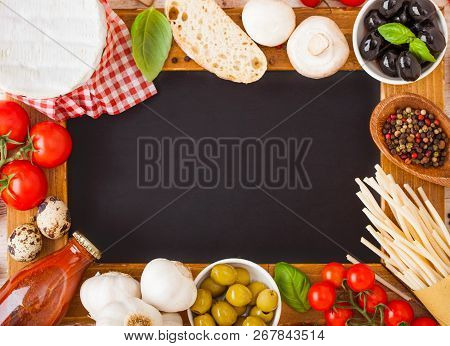 Charcoal Wooden Menu Board With Homemade Spaghetti Pasta With Quail Eggs And Cheese On Wood Backgrou