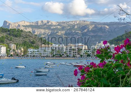 View Of Port De Soller In Majorca, Spain With Mountains In Background