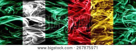 Nigeria, Nigerian Vs Guinea, Guinean Smoke Flags Placed Side By Side. Thick Abstract Colored Silky S