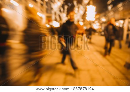 Crowded Street. Blurred Background. Blurred Silhouettes Of People On A City Street At Night In The L