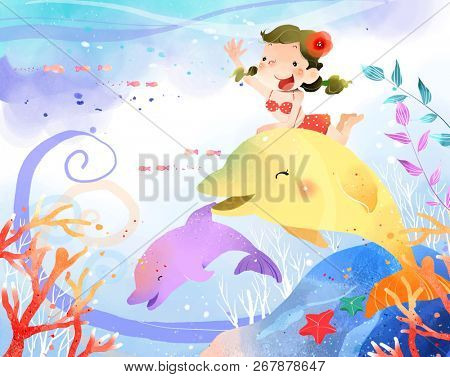 Girl riding on dolphin fish in water