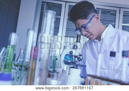 Health Care Researchers Working In Life Science Laboratory. Male Supervisor Preparing And Analyzing