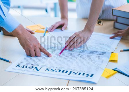 Close Up Hand Of Modern Business Adviser Meeting To Analyze And Discuss The Situation On The Newspap