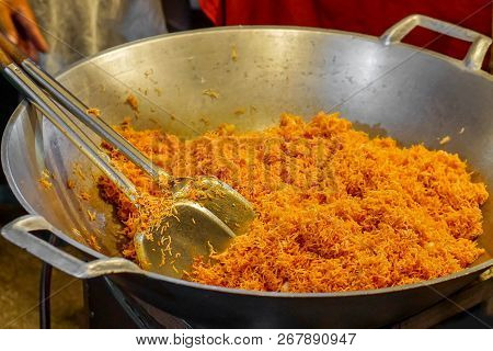 Chef Hand Holding Flippers Making Mee Krob In A Big Pan. Mee Krob Is A Popular Snacks In Thailand Th